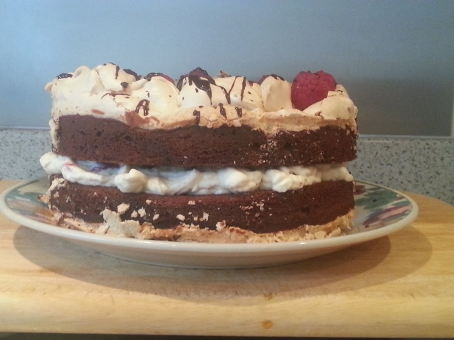 Chocolate brownie cake with hazelnut meringue and raspberry cream