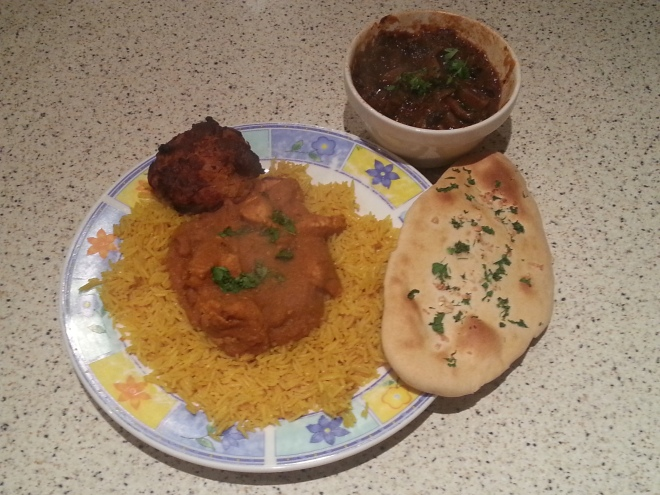 Chicken korai with mushroom bhaji, onion bhaji, pilau rice and garlic naan